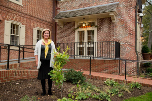 Carla Markell with the gordlinia donated to the governor's mansion by UD Botanic Gardens.