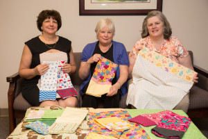 Michelle Rodgers (left), Donna Bailey (middle), and Alice Moore (right), made pillow cases to donate to an orphanage in Romania