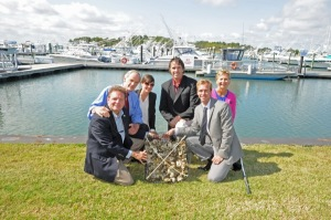 Celebrating UD's efforts to support aquaculture in Delaware's Inland Bays are David Small, DNREC secretary; Sen. Tom Carper; Sunny Jardine, UD's College of Earth, Ocean, and Environment; Ed Lewandowski, Delaware Sea Grant; Chris Bason, Center for the Inland Bays; and Kathy Beisner, U.S. Department of Agriculture.
